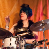Kori Heppner keeps the beat under a pill box hat..
