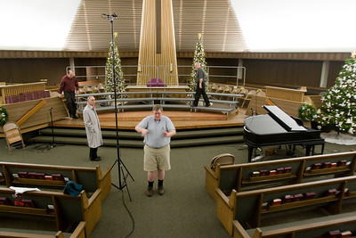 This is how a concert begins, with the installation of the risers for the singers to stand on, microphones for recording the performance, and positioning all in the right place.