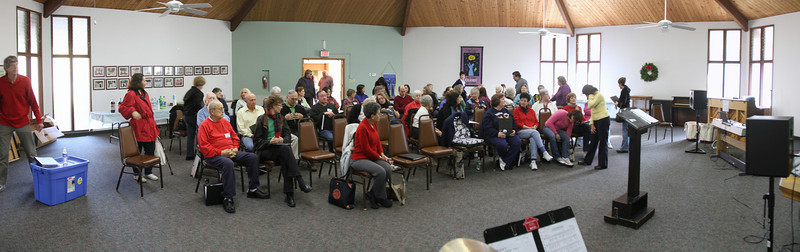Around 80 singers gather to go over their Christmas season concert music.