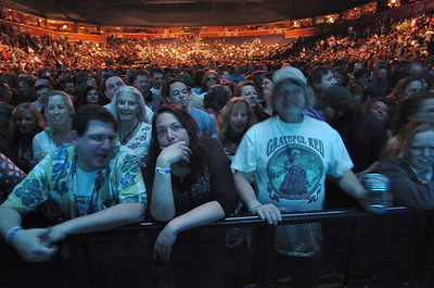 Allison Dunn, center from Longmont, Jeremy Grossbard, left from Phoenix, AZ  and Todd Richards from Bailey listen to Furthur with Phil Lesh and Bob Weir playing at  the opening night  of the 1stBank Center on Friday.