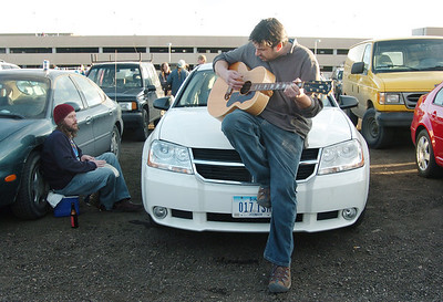 Furthur and Grateful Dead  fans  for 20 years, Derik Perez, right, and Joe Stock, both from Iowa, play music in the parking lot before the opening night  concert at the 1stBank Center on Friday.  March 5, 2010 Staff photo/David R. Jennings