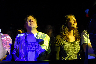 Furthur fans Jeremy Grossbard, left, and Allison Dunn, listen to the opening night concert of the 1stBank Center on Friday.  March 5, 2010 Staff photo/David R. Jennings
