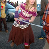 Ariel Graves, from Minnesota,  dances with a pole in a parking lot while waiting for the Furthur concert for opening night at the 1stBank Center on Friday.<br /> <br /> March 5, 2010<br /> Staff photo/David R. Jennings