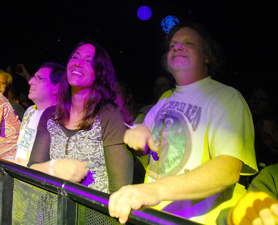 Front row fans Allison Dunn, center from Longmont, Jeremy Grossbard, left from Phoenix, AZ  and Todd Richards from Bailey listen to Furthur with Phil Lesh and Bob Weir playing at  the opening night  of the 1stBank Center on Friday.<br /> <br /> March 5, 2010<br /> Staff photo/David R. Jennings