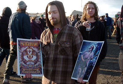 Yoram Shanan, from Boulder, sells Greatful Dead and Furthur posters to fans before the Furthur concert at the 1stBank Center on Friday.  March 5, 2010 Staff photo/David R. Jennings