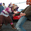Ariel Graves, from Minnesota,  helps Gian do the limbo in a parking lot while waiting for the Furthur concert for opening night at the 1stBank Center on Friday.<br /> <br /> March 5, 2010<br /> Staff photo/David R. Jennings