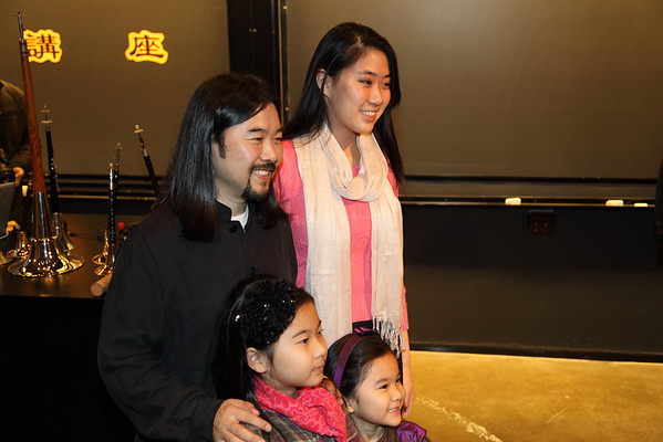 Our Youth Ensemble dizi player, Kimberly Huang taking picture with YaZhi Guo after seminar 2012-12-01 YaZhi Guo Suona Seminar