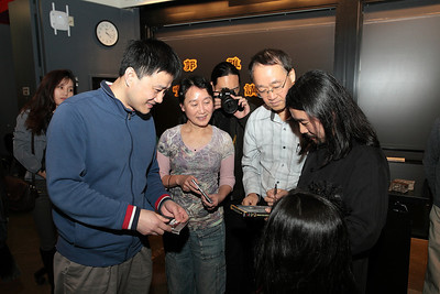 Left, Hui Huang and second left, Virginia Payne, who answered the questions and won a newly released CD by YaZhi Guo. They asking for autograph from Guo. 2012-12-01 YaZhi Guo Suona Seminar Photo by Hui Zhu