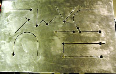 detail of custom aluminum tongue-plate made for composer Paul Hepker