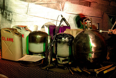 Assorted LP tanks, Jerry cans, artillery shell, and brake drum.  Part of the MotoArt gig setup.