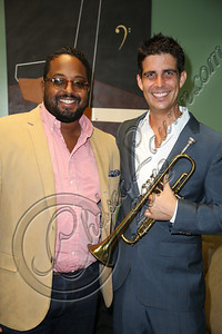HOLLYWOOD, CA - SEPTEMBER 20:  Musician Gabriel Johnson (R) and manager Aaron Davis pose up backstage at Catalina Jazz Club Bar & Grill on September 20, 2012 in Hollywood, California.  (Photo by Chelsea Lauren/WireImage)