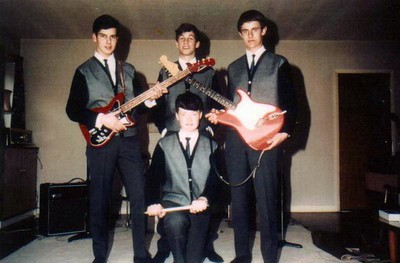 1 of 11  band nameThe Blue Diamonds   submitted by Neil Burman  who's in the picture Left to right clockwise: Neil Burman, bass; Iain Eggeling, rhythm guitar and lead vocals; David Jackson, lead guitar; John Woolley, drums. where was the band based Surrey / South London (Cheam, Epsom, Wimbledon), UK.   years active 1964-1966  musical influences Shadows, Beatles, Rolling Stones, Kinks, Zombies   notes Most 60's bands comprised three musicians and a drummer. The Blue Diamonds had three musicians and a guy who'd purchased a bass guitar because it had only four strings...   David Jackson (lead guitar) and John Woolley (percussion) teamed up as eleven-year-olds doing covers of anything by The Shadows. The two boys separated when they went to secondary school where John persuaded a fellow Kings College Wimbledon student Iain Eggeling (rhythm guitar and lead vocals) to join the fledgling band in October 1963. David then asked a boy from his school, Epsom College, to complete the band in April 1964. I added bass guitar and Van Gogh's ear for music.   We underwent a name change from The Avengers to The Blue Diamonds and wore uniforms of black cardigans with silver fronts, thin blue ties, white shirts and grey school trousers. Although we didn't look exactly like four Val Doonicans, we came dangerously close. We played at dances, clubs and private parties for two years including a gig attended by the French Ambassador. Our musical style became known as The Cheam Sound – a style occasionally mentioned in the same sentence as The Mersey Sound, The Motown Sound and The West Coast Sound, but not all that occasionally. We refused to perform easy listening music. Sometimes the audience found it easier not listening and left early.   The Blue Diamonds recorded an EP of three covers and an original instrumental in January 1965, selling several copies to each other. The band broke up just over a year later. Most blamed Yoko, but there were rumours about drug taking. Someone had seen I