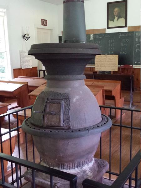 Potbelly stove inside schoolhouse - Quiet Valley Farm