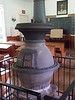 Potbelly stove inside schoolhouse - Quiet Valley Farm