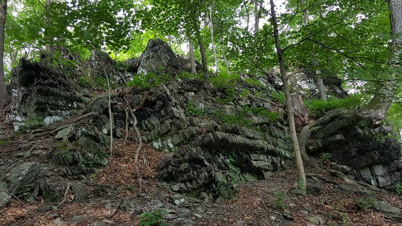 Rock outcropping above the farm