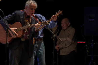 George Wein, in the wings enjoying David Amram and Pete Seeger.