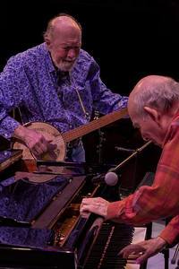 Pete Seeger and George Wein finding the right key at sound check.