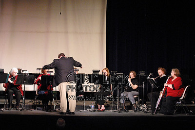 John Northe conducts the Eastwinds Flute Choir