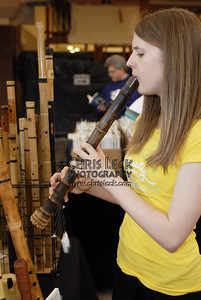 Trying out the wooden flutes