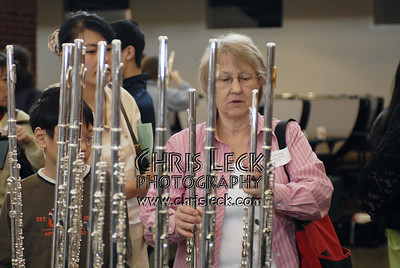 Rosemary Wood collecting flutes for her students to test