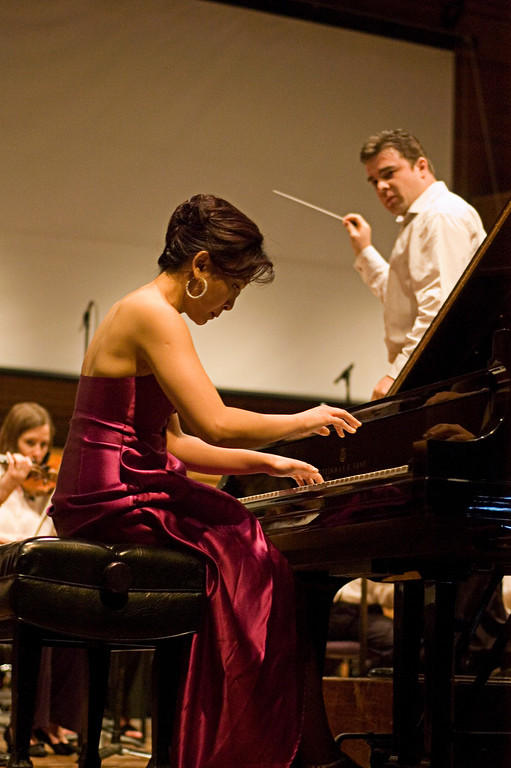 Conductor Michael Christie looks over his shoulder at pianist Jie Chen.