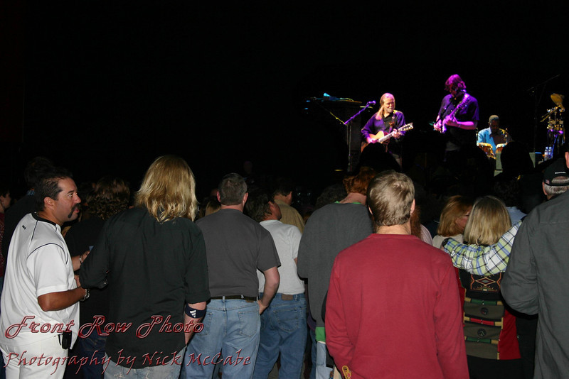 This is a composite (2 photos) I did with Gregs son in the foreground (black shirt) watching his father on stage.