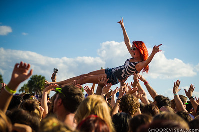 A fan crowd surfs while Grouplove performs on December 1, 2012 during 97X Next Big Thing at Vinoy Park in St. Petersburg, Florida
