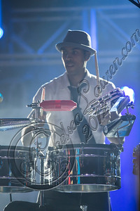 "LOS ANGELES, CA - AUGUST 25:  Percussionist Justin ""El Nino"" Poree of Ozomatli performs at Univision Radio's H2O music festival at Los Angeles Historical Park on August 25, 2012 in Los Angeles, California.  (Photo by Chelsea Lauren/WireImage)"