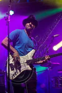 LOS ANGELES, CA - AUGUST 25:  Bassist Wil-Dog Abers of Ozomatli performs at Univision Radio's H2O music festival at Los Angeles Historical Park on August 25, 2012 in Los Angeles, California.  (Photo by Chelsea Lauren/WireImage)