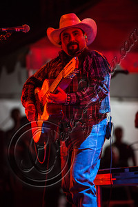LOS ANGELES, CA - AUGUST 25:  Musician Johnny Lee Rosas of Intocable performs at Univision Radio's H2O music festival at Los Angeles Historical Park on August 25, 2012 in Los Angeles, California.  (Photo by Chelsea Lauren/WireImage)