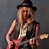 Guitarist wears a hat