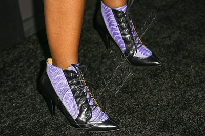LOS ANGELES, CA - AUGUST 01:  Singer Santigold (shorts detail) arrives at Hennessy's unveiling of a limited edition bottle designed by street artist Futura at Milk Studios on August 1, 2012 in Los Angeles, California.  (Photo by Chelsea Lauren/WireImage)