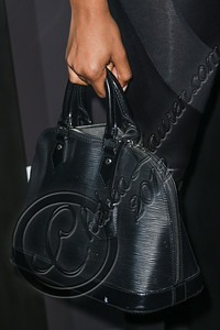 LOS ANGELES, CA - AUGUST 01:  Model Claudia Jordan (purse detail) arrives at Hennessy's unveiling of a limited edition bottle designed by street artist Futura at Milk Studios on August 1, 2012 in Los Angeles, California.  (Photo by Chelsea Lauren/WireImage)