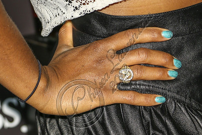 LOS ANGELES, CA - AUGUST 01:  Singer Santigold (nail polish and ring detail) arrives at Hennessy's unveiling of a limited edition bottle designed by street artist Futura at Milk Studios on August 1, 2012 in Los Angeles, California.  (Photo by Chelsea Lauren/WireImage)