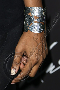 LOS ANGELES, CA - AUGUST 01:  Model Claudia Jordan (bracelet detail) arrives at Hennessy's unveiling of a limited edition bottle designed by street artist Futura at Milk Studios on August 1, 2012 in Los Angeles, California.  (Photo by Chelsea Lauren/WireImage)