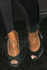 LOS ANGELES, CA - AUGUST 01:  Model Claudia Jordan (shoe detail) arrives at Hennessy's unveiling of a limited edition bottle designed by street artist Futura at Milk Studios on August 1, 2012 in Los Angeles, California.  (Photo by Chelsea Lauren/WireImage)