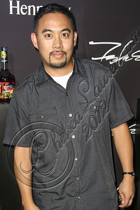 LOS ANGELES, CA - AUGUST 01:  DJ E-Man arrives at Hennessy's unveiling of a limited edition bottle designed by street artist Futura at Milk Studios on August 1, 2012 in Los Angeles, California.  (Photo by Chelsea Lauren/WireImage)