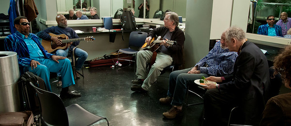 Henry Butler listening to Josh White Jr. and John Sebastian jamming while Pete Seeger and David Amram grab a bite and chat in the Symphony Space green room before the George Wein Tribute Concert in NYC.