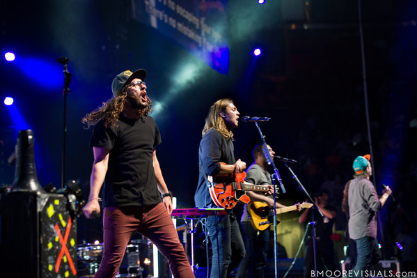 "Jonathon ""J.D."" Douglass, Joel Houston, Jad Gillies, and Matthew Crocker of Hillsong United perform in support of Aftermath before a sold-out crowd at American Airlines Arena on August 6, 2011 in Miami, Florida"
