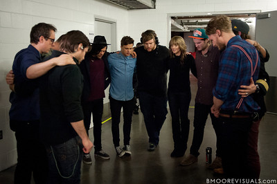 Hillsong United say a quick prayer before taking the stage for their sold-out show at American Airlines Arena on August 6, 2011 in Miami, Florida