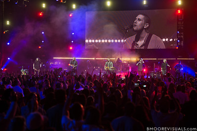 "Jonathon ""J.D."" Douglass, Joel Houston, Jad Gillies, Matthew Crocker, and Hayley Law of Hillsong United perform in support of Aftermath before a sold-out crowd at American Airlines Arena on August 6, 2011 in Miami, Florida"