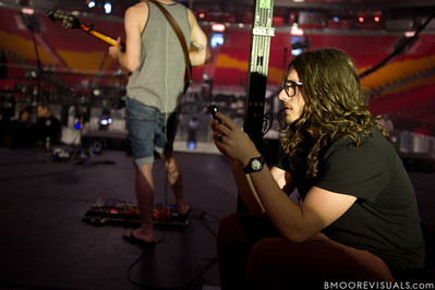 "Jonathon ""J.D."" Douglass of Hillsong United checks his messages during soundcheck at American Airlines Arena on August 6, 2011 in Miami, Florida"
