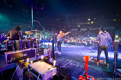 Simon Kobler, Joel Houston, and Timon Klein of Hillsong United perform in front of a sold out crowd on August 5, 2011 at St. Pete Times Forum in Tampa, Florida