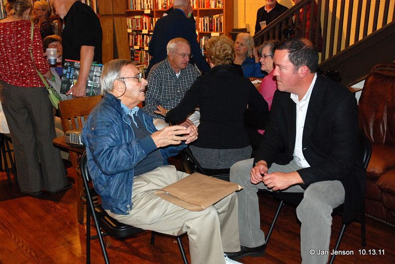 Crowd at the Literary Bookpost in Salisbury, NC on Thursday, October 13, 2011.<br /> Ben Martin (photographer for TIME, LIFE, Fortune, People and many other magazines), talking with Sam Stephenson, author of The Jazz Loft Project book.