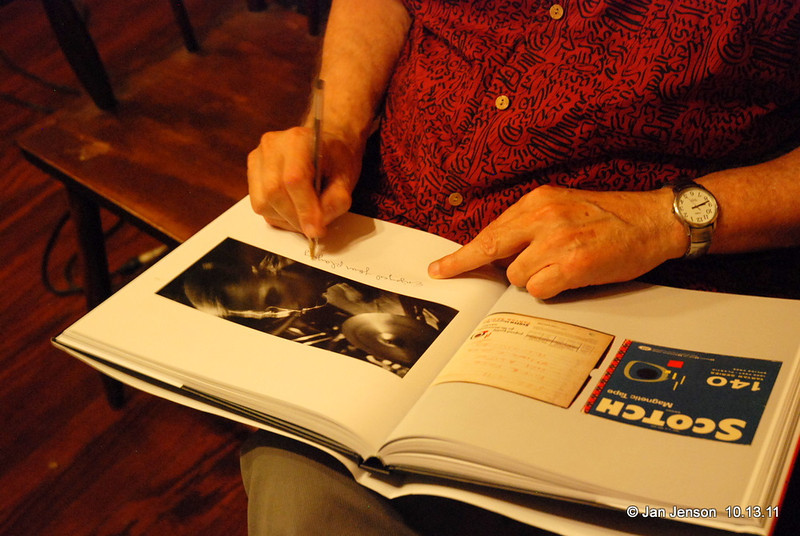 Ron Free signing his name under one of the photos of him in the Jazz Loft Project book.