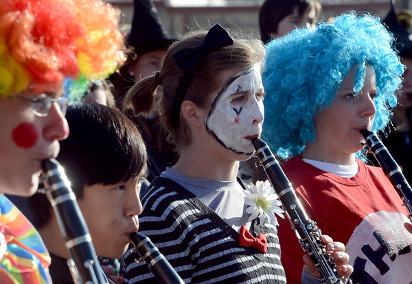 """Mackinley Kath, center, plays a mime, while playing the the Longmont High School Marching Band.<br /> The annual Longmont Halloween Parade and Trick or Treat Street was held down Main Street Saturday morning<br /> For more photos and a video, go to  <a href=""""http://www.timescall.com"""">http://www.timescall.com</a>.<br /> Cliff Grassmick  / October 27, 2012"""