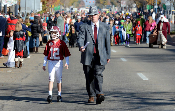 """Jackson Appling, 9, is playing Joe Namath, and Keith Appling is coach Bear Bryant, in the Halloween parade<br /> The annual Longmont Halloween Parade and Trick or Treat Street was held down Main Street Saturday morning<br /> For more photos and a video, go to  <a href=""""http://www.timescall.com"""">http://www.timescall.com</a>.<br /> Cliff Grassmick  / October 27, 2012"""