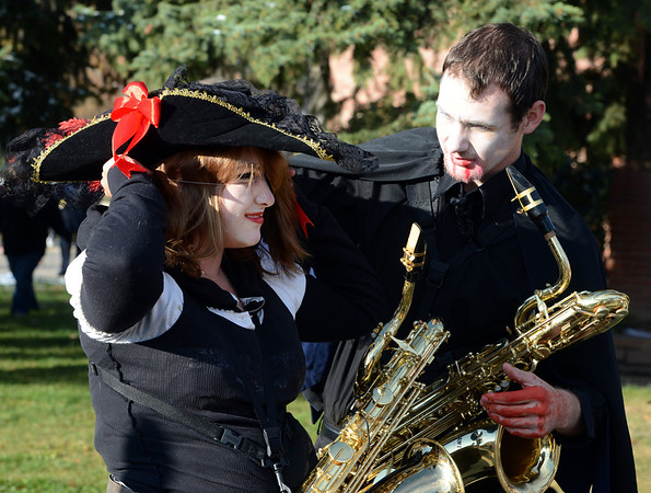 "Kayla Mallory, left, and Jordan Bessee, both seniors in the Longmont High School Marching Band, adjust their costumes before the parade.<br /> The annual Longmont Halloween Parade and Trick or Treat Street was held down Main Street Saturday morning<br /> For more photos and a video, go to  <a href=""http://www.timescall.com"">http://www.timescall.com</a>.<br /> Cliff Grassmick  / October 27, 2012"