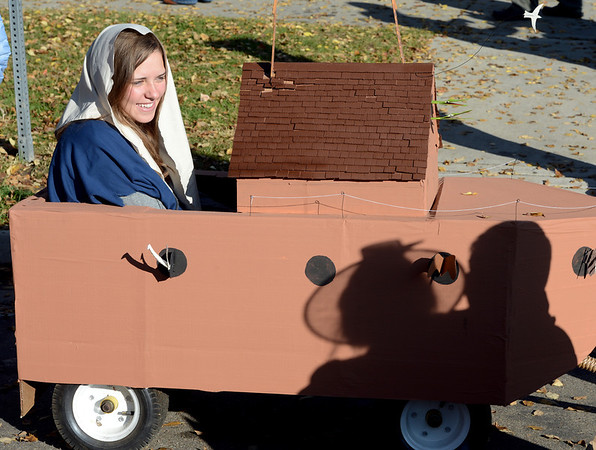 """Myra Sommerville, playing Noah's wife, rides out the storm in the Arc before the parade.<br /> The annual Longmont Halloween Parade and Trick or Treat Street was held down Main Street Saturday morning<br /> For more photos and a video, go to  <a href=""""http://www.timescall.com"""">http://www.timescall.com</a>.<br /> Cliff Grassmick  / October 27, 2012"""