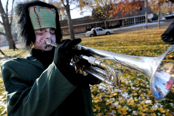 "Connor Hayes of the Longmont High School Marching Band, practices his part in the Halloween Parade before it began.<br /> The annual Longmont Halloween Parade and Trick or Treat Street was held down Main Street Saturday morning<br /> For more photos and a video, go to  <a href=""http://www.timescall.com"">http://www.timescall.com</a>.<br /> Cliff Grassmick  / October 27, 2012"